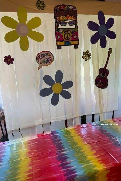 Tie dye background out of a table cloth and photo props.