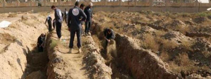 Hundreds of bodies found in mass graves near former ISIS stronghold