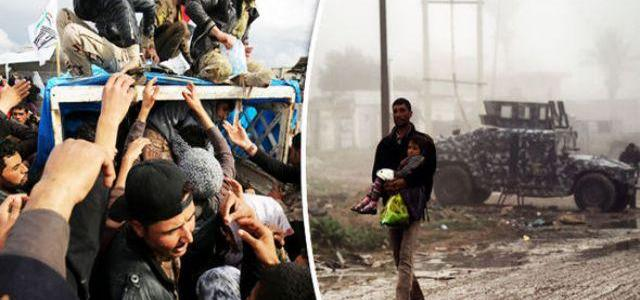 Desperate ISIS forces boys to fight and shoot families as 320,000 people flee Mosul
