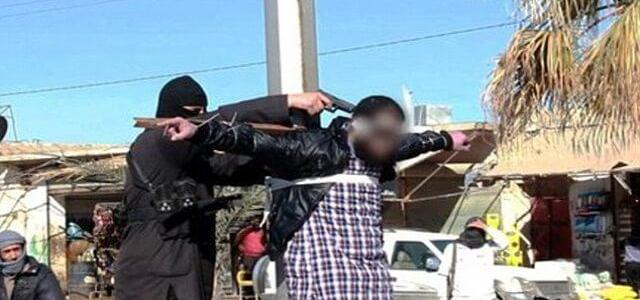 ISIS terrorists execute a rebel agent in Yarmouk Camp in Damascus
