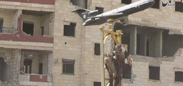 ISIS savages shoot down Syrian fighter jet, and mock dead pilot with a model jet as they crucify his corpse