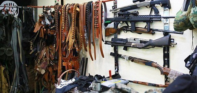 ISIS terror group releases images of store stocked with self-loading shotguns, daggers and telescopic scopes