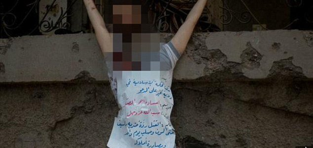 ISIS thugs behead blindfolded man and crucify his corpse in barbaric new images