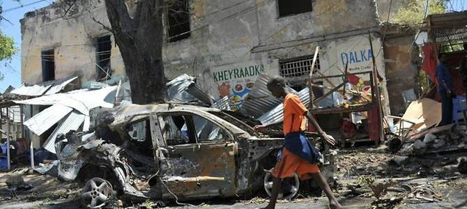 Car bombs gunfire hit government military base in southern Somalia