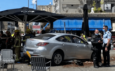 At least fifteen injured after vehicle runs into benches at Bat Yam cafe