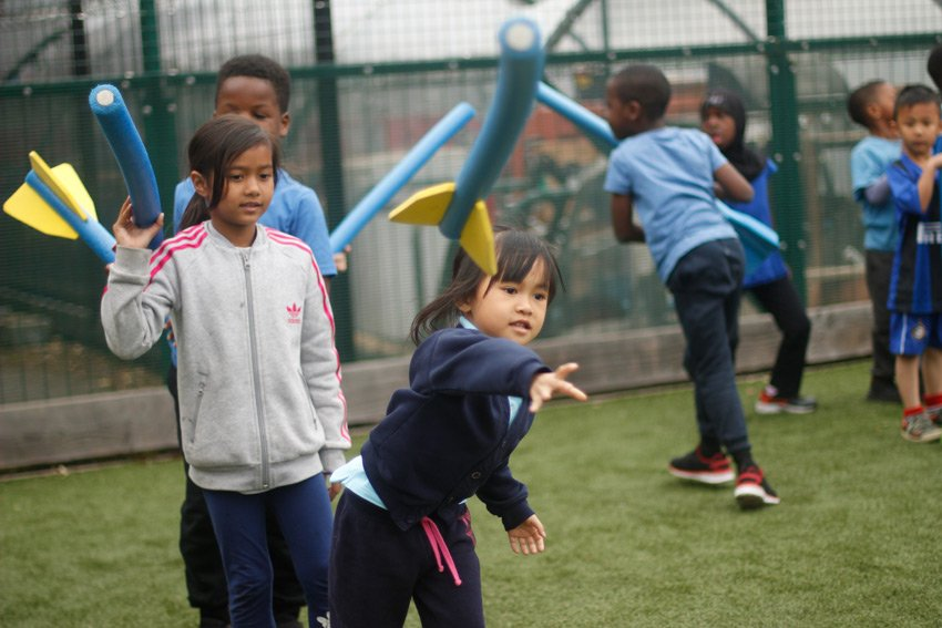 Children throwing rockets during a PE lesson