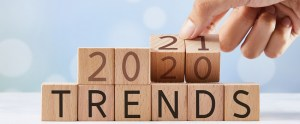 """Hand flipping wooden blocks and changing the expression """"trends 2020"""" to """"trends 2021"""""""