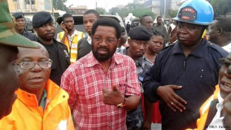 Alfred Oko Vanderpuije (Center)