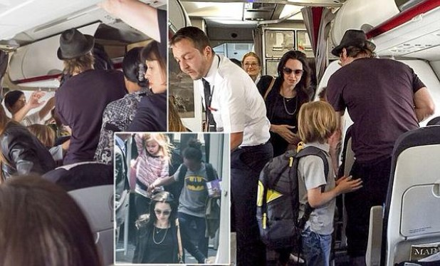 Angelina Jolie and Brad Pitt Fly Economy