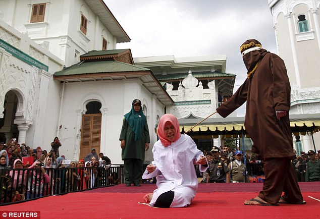 Two Lesbians Caned By Malaysian Sharia Court For Chopping Themselves Down In A Car