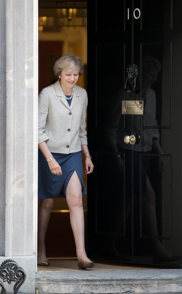 UK. Prime Minister Theresa May walks from Number 10 to meet with President of the European Council, Donald Tusk in Downing showing a lot of leg