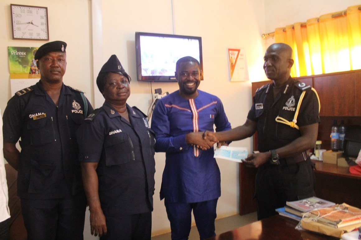 Dr. Boateng, CEO of Endpoint Homeopathic Clinic Presenting the Cheque to ACP Felix Kwasi Kosmos