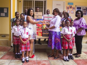 Madam Bernice (left) Presenting items to Mrs Assan