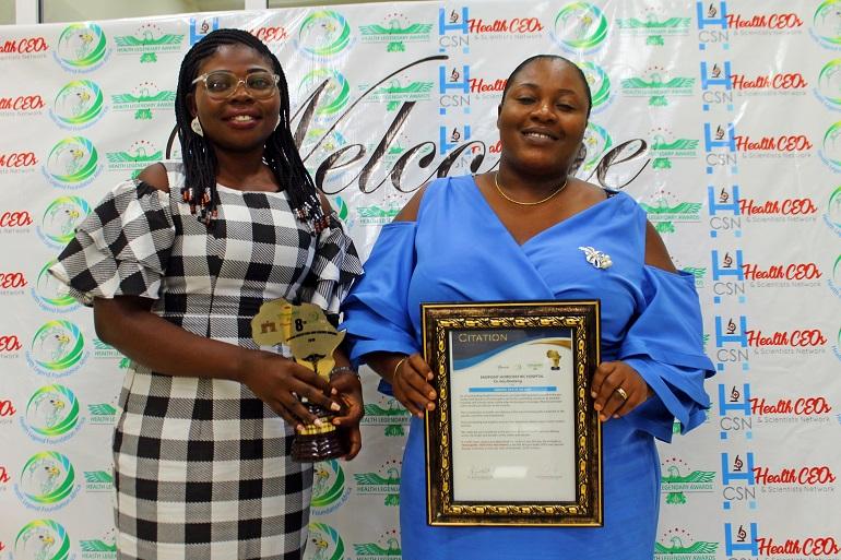 Mrs. Deborah Paintsil with the award