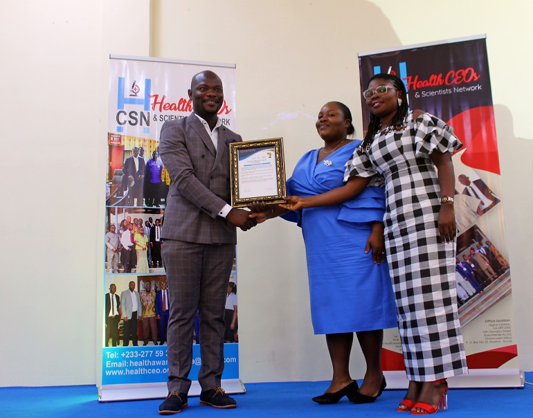 Mrs. Deborah Oaintsil (in blue) receiving the award on behalf of Dr. Adu Boateng
