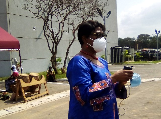 Madam Sophia Akuffo demonstrating how to properly wear a mask