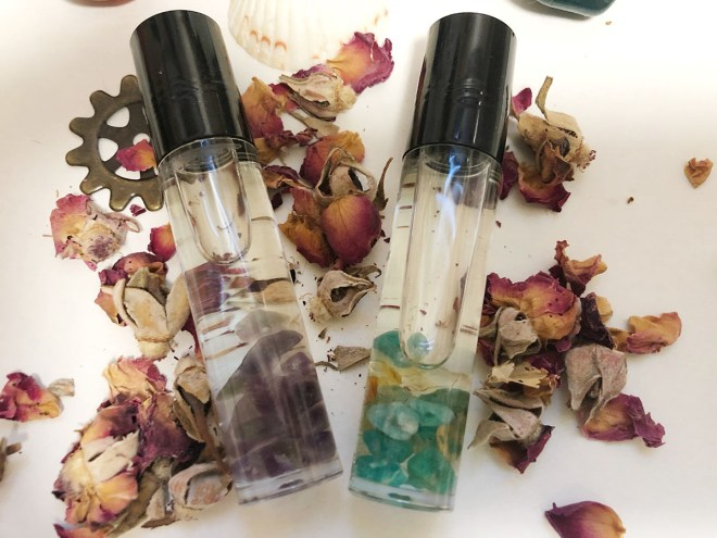 Two roller ball bottles with crystals and essential oils for protection