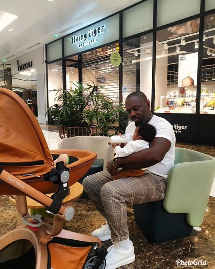 Jim Iyke Steps Out With His Newborn Son For Shopping 2 - Jim Iyke Steps Out With His Newborn Son For Shopping- Photos