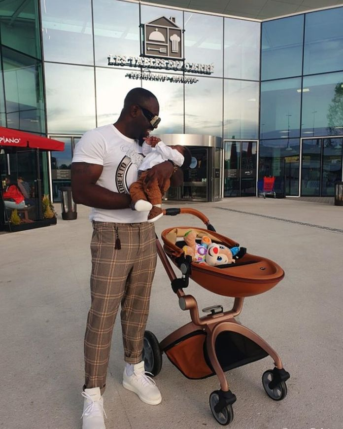 Jim Iyke Steps Out With His Newborn Son For Shopping - Jim Iyke Steps Out With His Newborn Son For Shopping- Photos