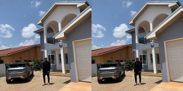 medi - Medikal Strikes A Pose In Front Of His Newly Acquired Mansion At East Legon