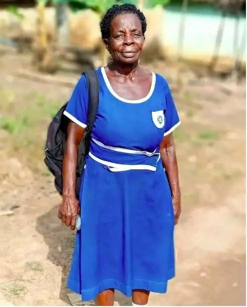 60-year-old woman writing BECE