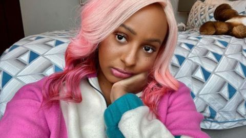 DJ Cuppy Causes Stir On Social Media With Her Weird Outfit As She Models To A Helicopter [Video]