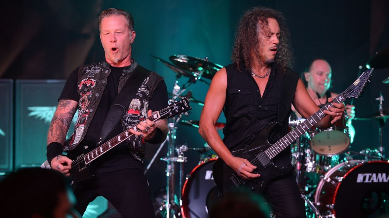 NEW YORK, NY - SEPTEMBER 21:  James Hetfield (L) and Kirk Hammett of Metallica perform private, exclusive concert for SiriusXM listeners at The Apollo Theater on September 21, 2013 in New York City.  (Photo by Theo Wargo/Getty Images for SiriusXM)