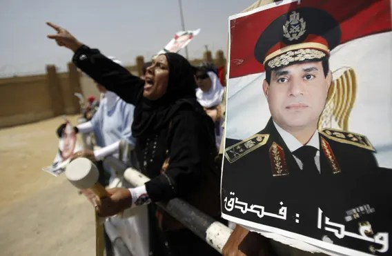 Supporters of Egypt's former President Mubarak shout slogans outside a police academy before Mubarak's trial in Cairo