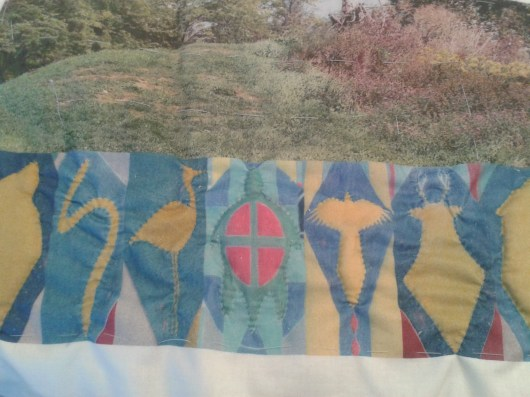 Beginning the quilting by outlining animals