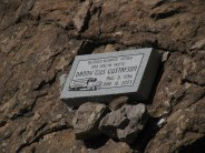 I don't know Gus Gustafson but he has an interesting memorial. This stone is on a rock just off US60 in the deep canyon a short distance east of Superior, Arizona. The canyon bottom is littered with the rusted remnants of other poor souls that have gone off the road.