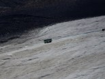 A snow bus crosses the Athabasca Glacier in Jasper Park.