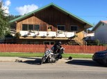 Ghost packs the Vector in front of our lucky find of a cheap rented room in Jasper, AB.