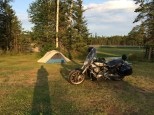 The photographers shadow stretches across the campsite for the evening at Nipigon, ON.