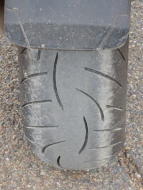 The Nightowl's rear tire after the neverending gravel getting to the Fort Peck Dam.