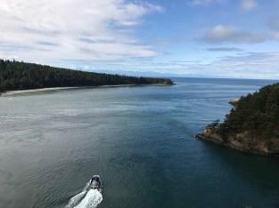 A tour boat navigates Deception Pass.