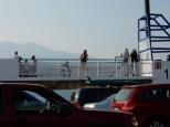 Passengers for my ferry crossing. At least one if more interested in the dog on the deck than the fire up the mountain.