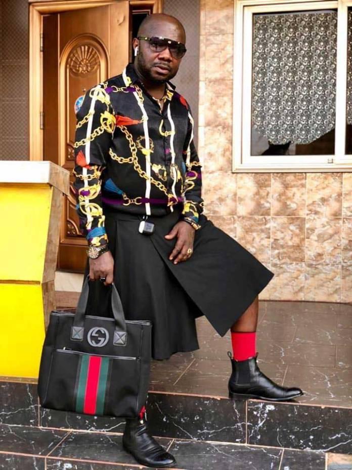Osebo wearing skirt shirt 4 - Photos of Nana Aba's baby daddy Osebo stylishly roaming town wearing skirt & shirt again go viral