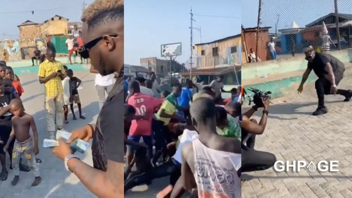 Medikal sprays money on the street for kids during a video shoot