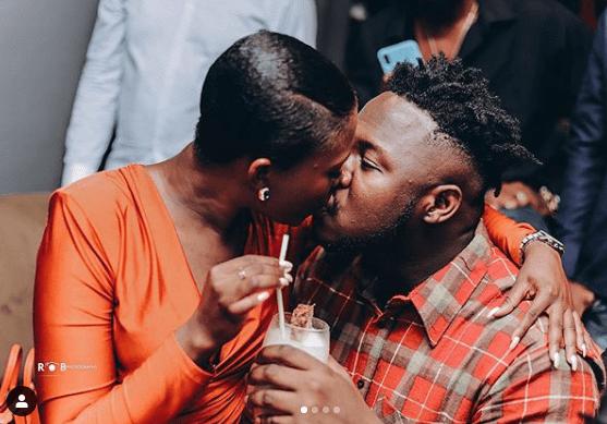 Medikal and fella share passionate kiss