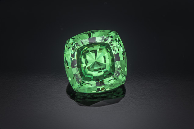 116.76 ct square cushion cut, one of the rarest cuts for Tsavorite. Photo by Robert Weldon/GIA, courtesy of Bruce Bridges.