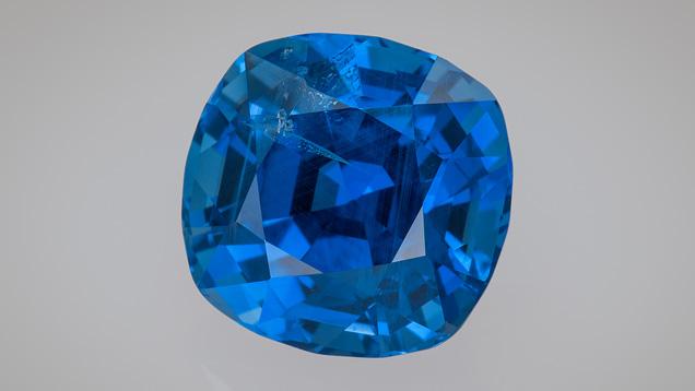 Cushion-cut Burmese sapphire cut by Glenn Preuss, 1.85 ct. Photo by Robert Weldon/GIA; courtesy of Glenn Preuss.