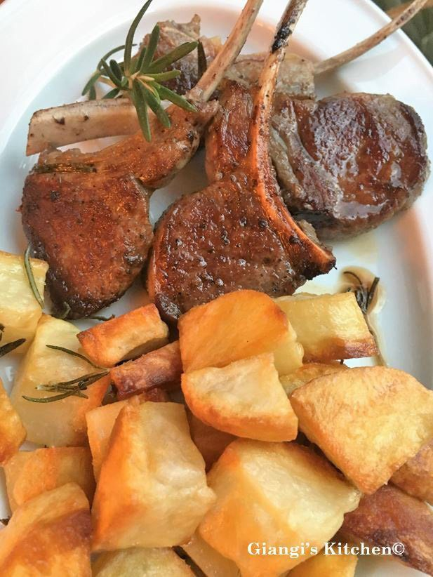 Roasted potatoes with lamb chops
