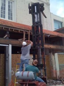 Workers tearing stuff down