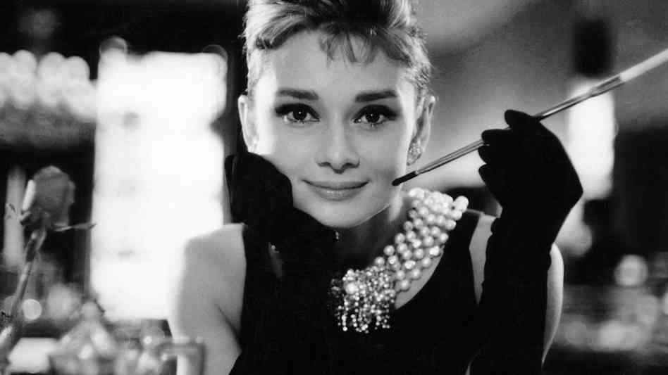 Holly Golightly from Breakfast at Tiffany's also wore pearls, and the look of the little black dress and gleaming white globes became an iconic image.
