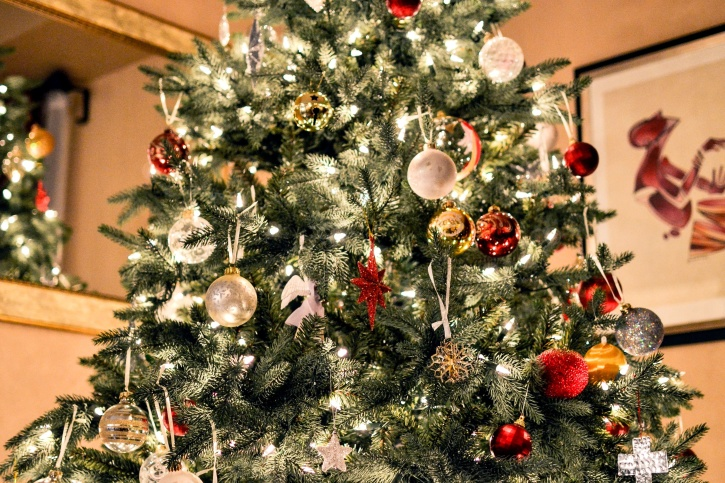 Decorating Christmas trees originated in 16th century Germany with hanging apples on trees to represent the biblical tree of forbidden fruit.
