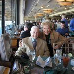 Gil and his wife pose for a photo at the Frontrunner restaurant at Santa Anita Park.