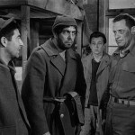 "Harvey Lembeck as Harry Shapiro, Robert Strauss as Stanislas ""Animal"" Kuzawa, Gil and Bill Holden as J.J. Sefton in Stalag 17"