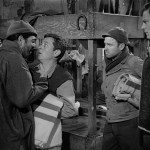 "Robert Strauss as Stanislas ""Animal"" Kuzawa accosts Gil (Cookie) in Stalag 17 as Neville Brand as Duke looks on"