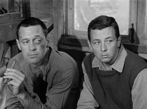 "Gil plays Clarence Harvey ""Cookie"" Cook - the sidekick to William Holden as J.J. Sefton in Stalag 17"