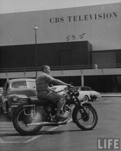 On His Motorcycle Stratton arrives for work at CBS's TV City. Besides scaling hills on it, he once rode it all the way to his home in Chicago. From LIFE Magazine